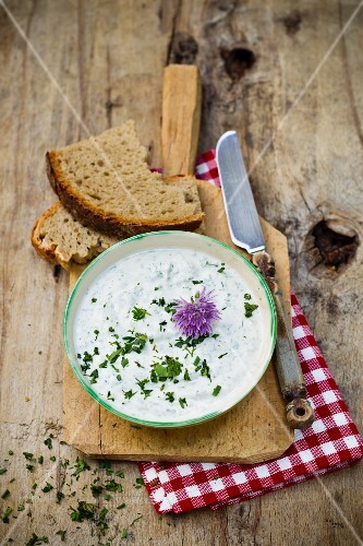 A herb dip with a chive flower