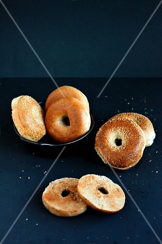 Sesame seed bagel, whole and halved
