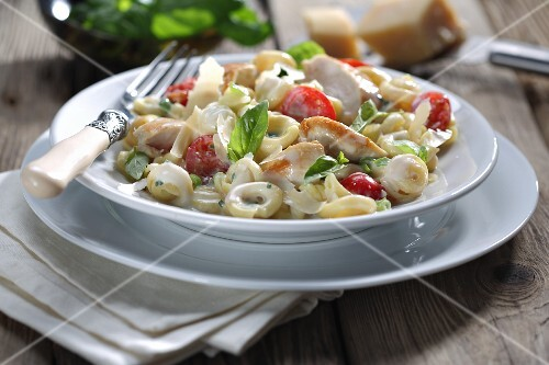 Tortellini with chicken and tomatoes in a creamy sauce