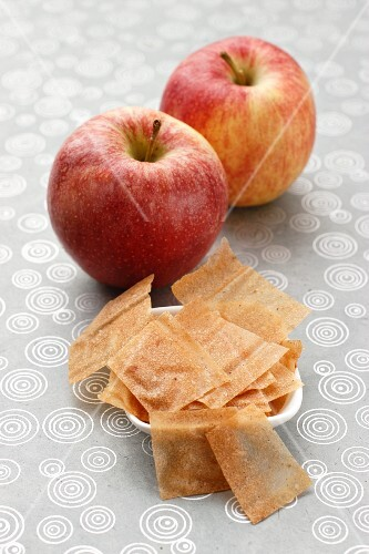 Twp apples and a dish of apple jelly paper