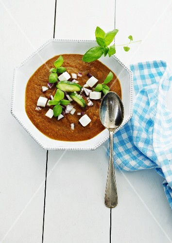 Vegetables soup with cucumber, feta and basil