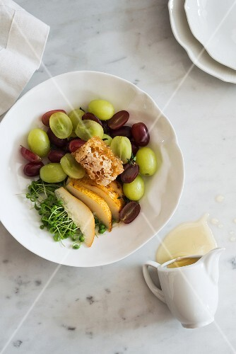 Pear and grape salad with honey and cress