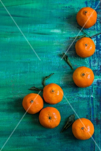 Clementines on a turquoise surface