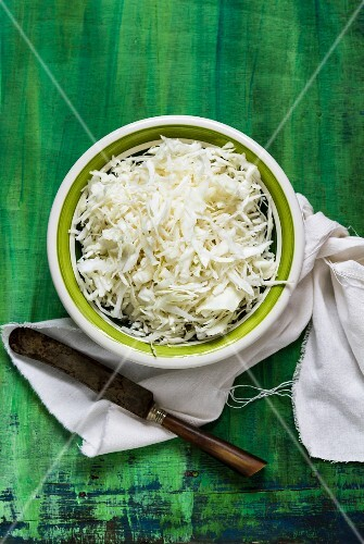 A bowl of sliced white cabbage