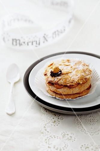 A hazelnut cream tartlet on a plate for Christmas