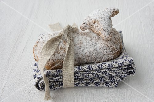 A sweet Easter lamb on a tea towel with a ribbon
