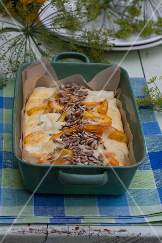Pepper bake with sunflower seeds in a baking dish