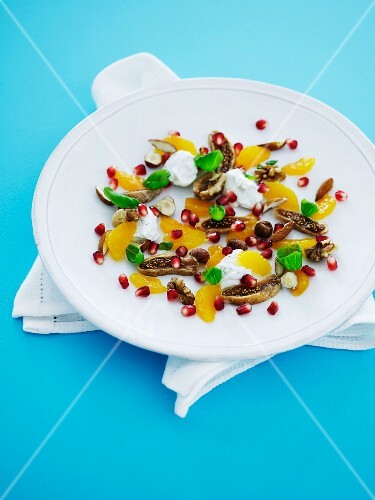 Orange and walnut salad with pomegranate seed and dried figs