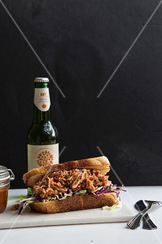 A pulled pork sandwich and a beer