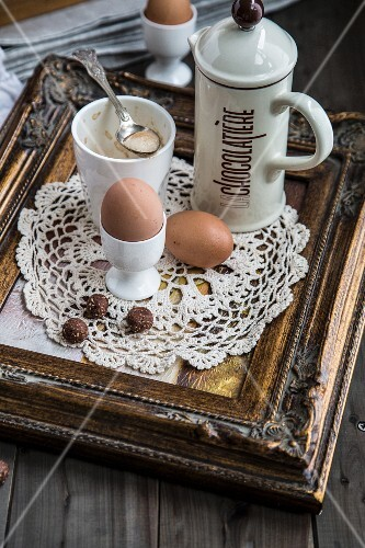 Eggs and cocoa on a breakfast tray