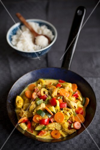 Fried vegetable, chicken and rice curry
