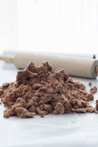 Chocolate dough for cookies with a rolling pin