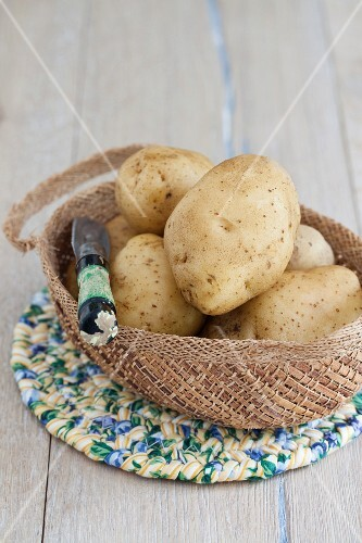 New potatoes with a peeler