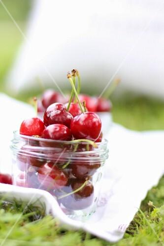 A jar of fresh cherries