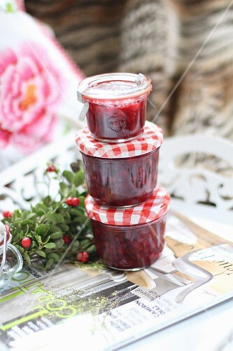 A stack of three jars of cranberry jam