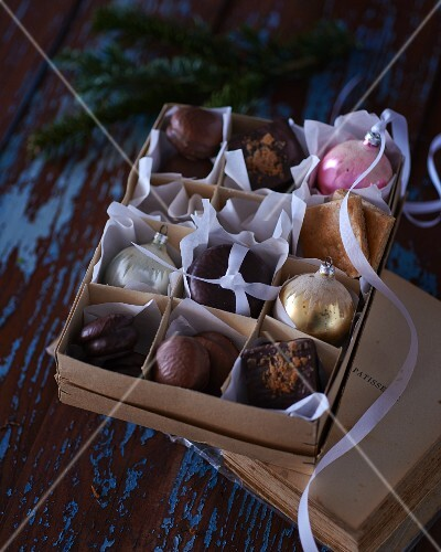 A box of various Christmas biscuits and Christmas tree decorations