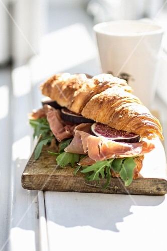 A croissant with prosicutto, figs and rocket