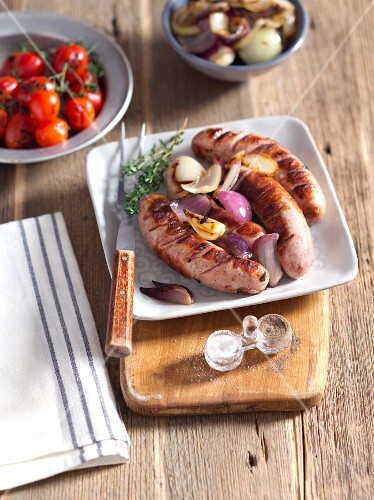 Grilled white sausage with onions