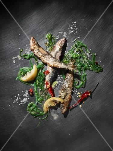 Grilled sardines with seaweed, lemons, chilli and sea salt