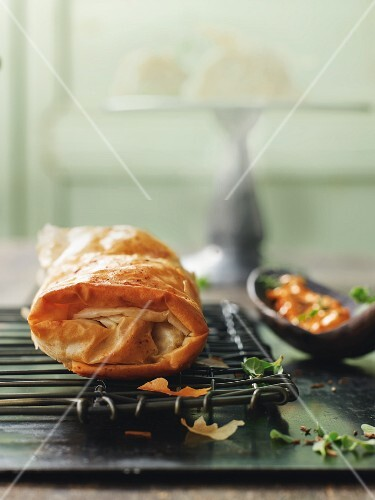 Cabbage and grape strudel with a pepper and caraway dip
