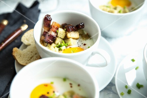 Oeufs cocotte with bacon and croutons