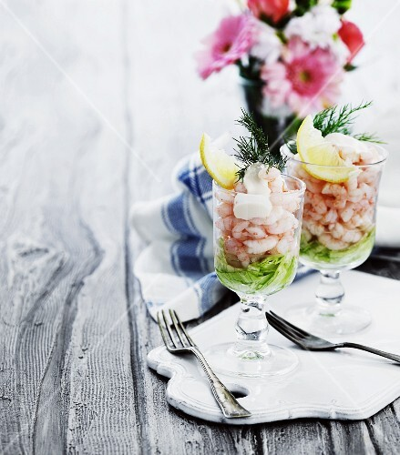 Two glasses of prawn cocktail on salad