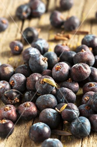 Juniper berries on a wooden surface