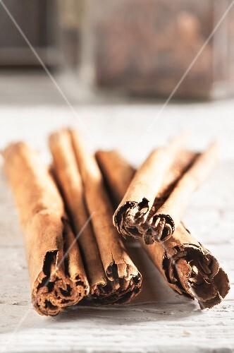 Cinnamon sticks on a wooden surface