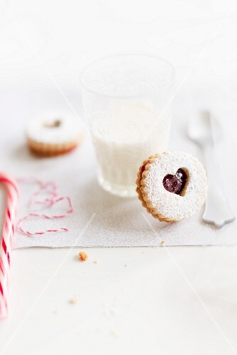 Linzer Augen (nutty shortcrust jam sandwich biscuits with holes on top) and a glass of milk for Christmas