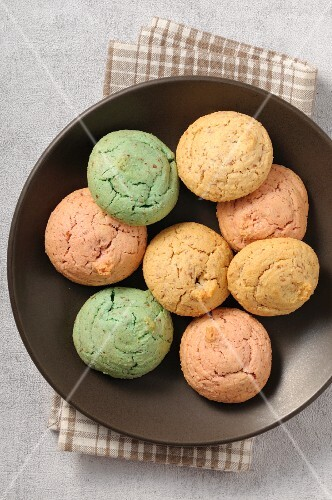 A bowl of pastel-coloured macaroons