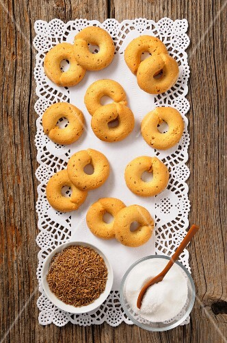 Aniseed rings, aniseed and sugar on a doily