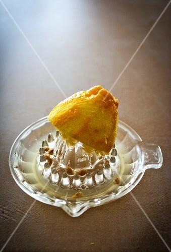 A lemon half on a juicer