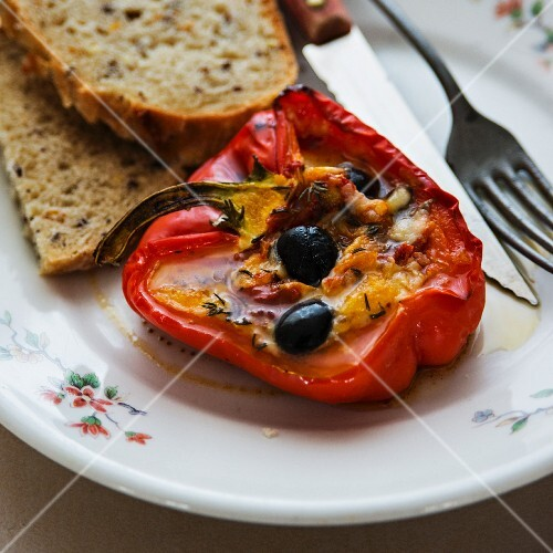 A pepper filled with olives and feta cheese