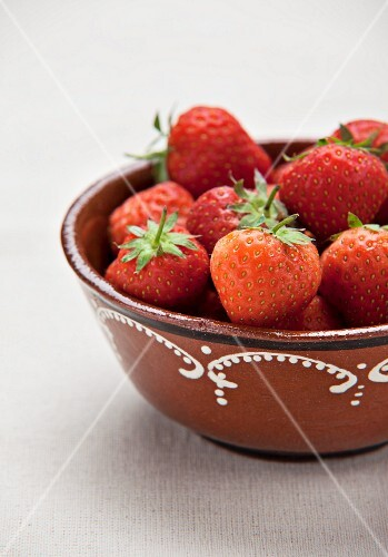 Fresh strawberries in a ceramic bowl