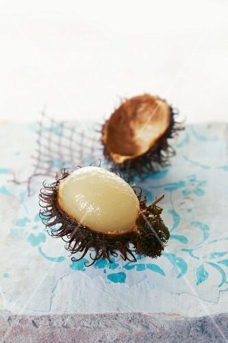 Rambutan, partly peeled