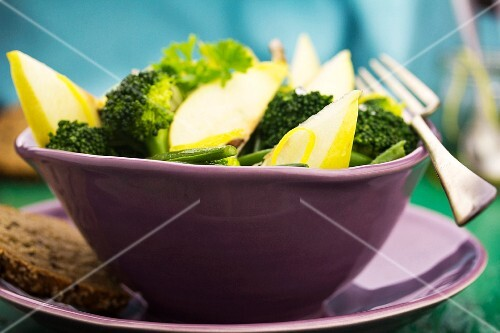 Broccoli and pear salad in a purple bowl