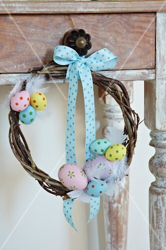 Hand-crafted willow wreath decorated with colourful eggs & ribbon
