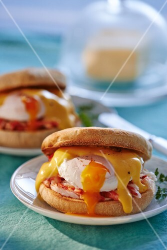 Eggs Benedict (muffins with poaches eggs and sauce Hollandaise)