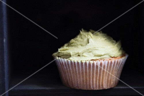 A cupcake with matcha frosting
