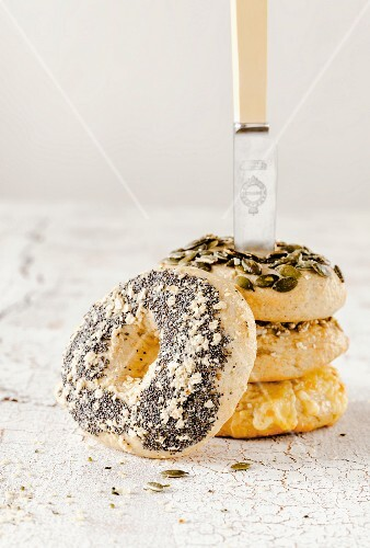 A tower of bagels with a knife
