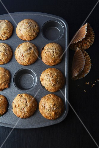 Freshly baked carrot muffins in a muffin tin