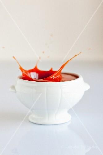 Splashing tomato soup