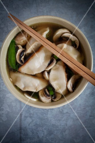 Miso soup with ginger, mange tout, spring onions, mushrooms and gyoza (Japan)