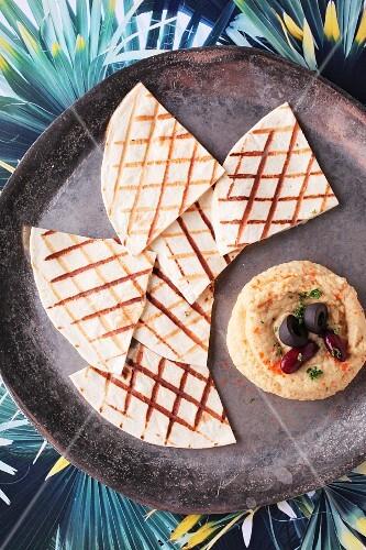 Unleavened bread with hummus