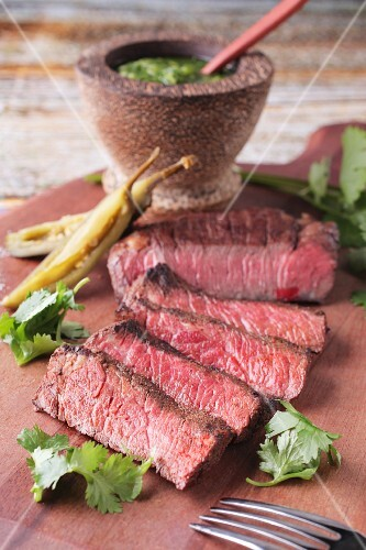 Grilled beef steak with chilli peppers, coriander and salsa verde (Mexico)