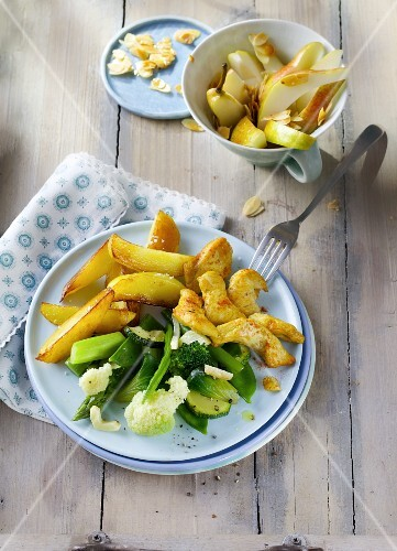 Curried chicken with green vegetables and potato wedges