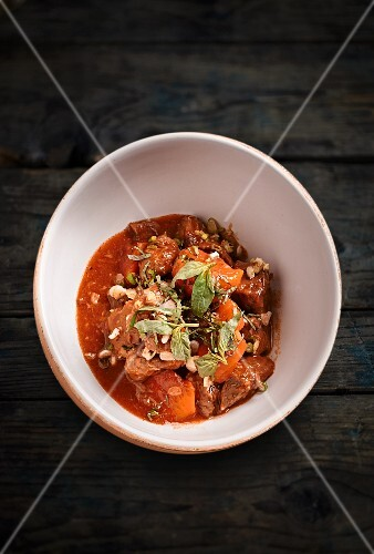 Beef stew with carrots and fresh herbs