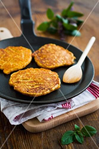 Sweet potato cakes in a pan