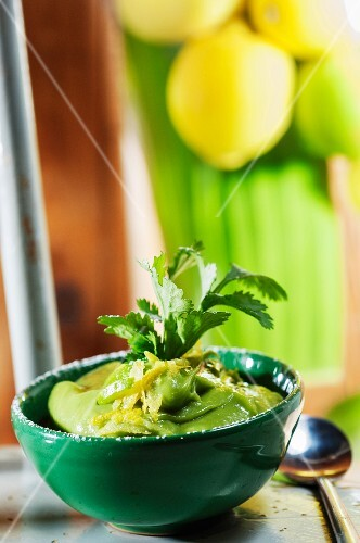 Cold avocado cream with grated lime and fresh mint