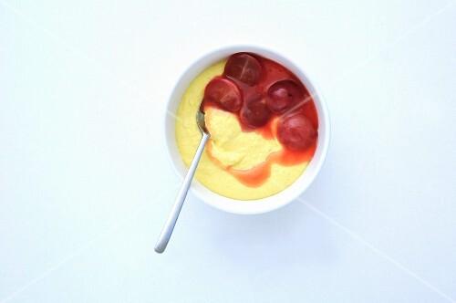 Saffron cream with red grapes